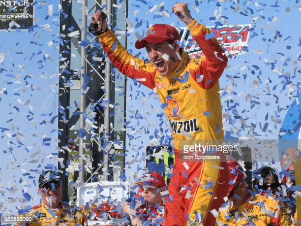Joey Logano Team Penske Ford Fusion Shell Pennzoil celebrates in Victory Lane after winning the Monster Energy Cup Series 49th Annual Geico 500 on...