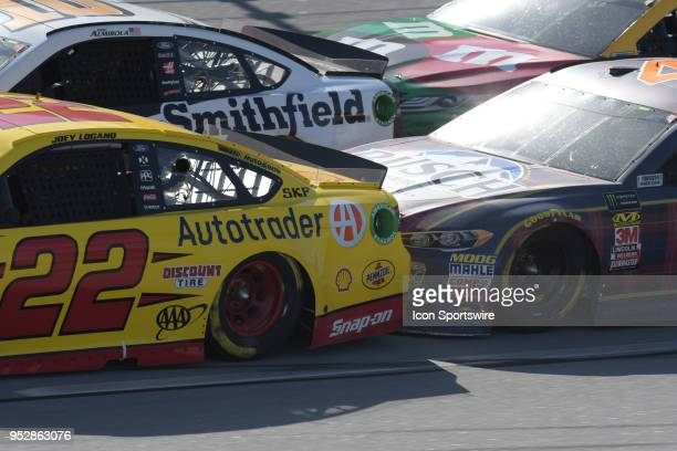 Joey Logano Team Penske Ford Fusion Shell Pennzoil is pushed by Kevin Harvick StewartHaas Racing Ford Fusion Busch Beer Flannel on a restart during...
