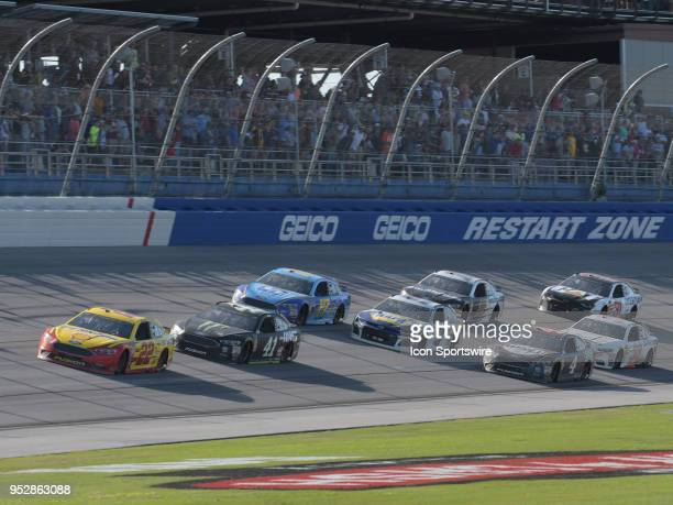 Joey Logano Team Penske Ford Fusion Shell Pennzoil leads the field to the checkered flag during the Monster Energy Cup Series 49th Annual Geico 500...