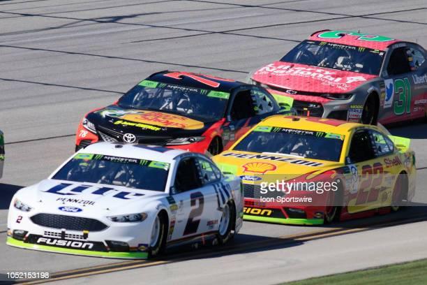 Joey Logano Team Penske Ford Fusion Shell Pennzoil pushes Brad Keselowski Team Penske Ford Fusion Miller Lite during the running of the 1000Bulbscom...