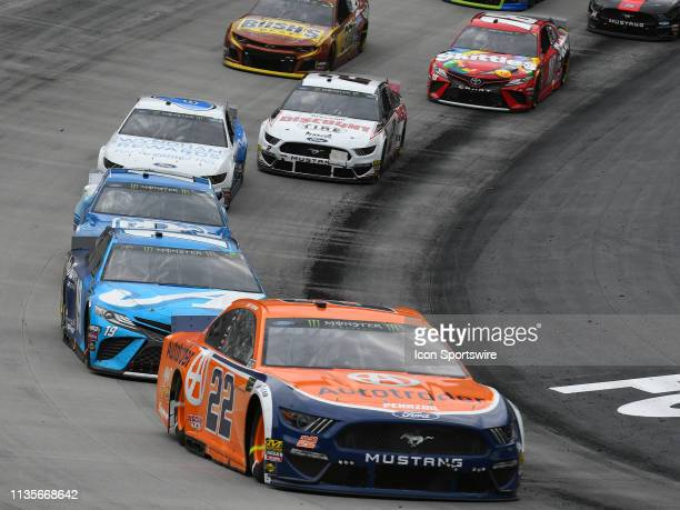 Joey Logano Team Penske Ford Mustang Shell Autorader leads Martin Truex Jr Joe Gibbs Racing Toyota Camry Auto Owners Insurance during the Monster...