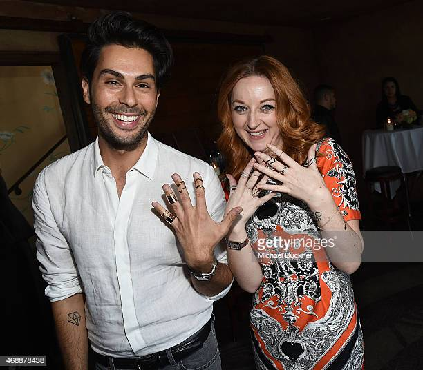 Joey Maalouf and Katrina Barton shop for Wanderlust + Co Jewelry at The Glam App's Glamchella at the Petit Ermitage on April 7, 2015 in Los Angeles,...