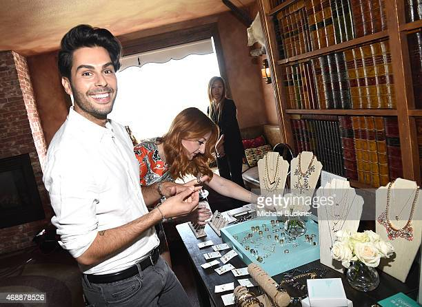 Joey Maalouf shops for Wanderlust + Co Jewelry at The Glam App's Glamchella at the Petit Ermitage on April 7, 2015 in Los Angeles, California.