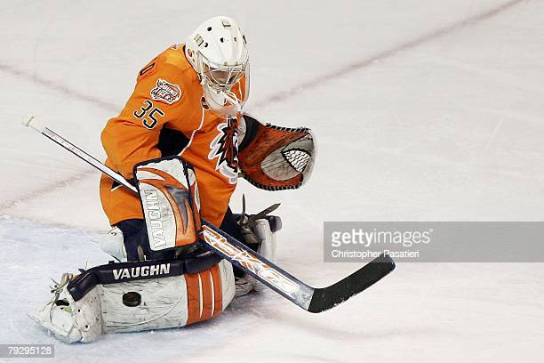 Joey MacDonald of the Bridgeport Sound Tigers makes a pad save during the first period against the Philadelphia Phantoms on January 23, 2008 at the...