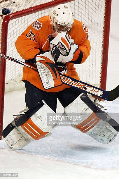 Joey MacDonald of the Bridgeport Sound Tigers makes a save during the first period against the Philadelphia Phantoms on January 23 2008 at the Arena...