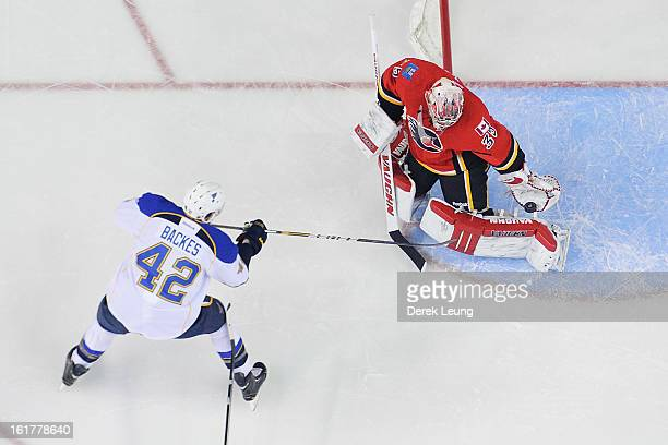 Joey MacDonald of the Calgary Flames makes a glove save on the shot of David Backes of the St Louis Blues during an NHL game at Scotiabank Saddledome...