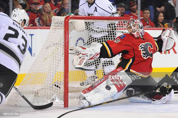 Joey MacDonald of the Calgary Flames makes a pad save on the shot of Dustin Brown of the Los Angeles Kings during an NHL game at Scotiabank...