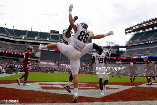 Joey Magnifico and Tyce Daniel of the Memphis Tigers react against the Temple Owls at Lincoln Financial Field on October 12, 2019 in Philadelphia,...