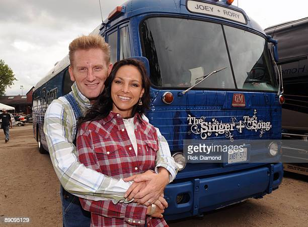Joey Martin Feek and Rory Lee Feek of singer/Songwriter duo Joey + Rory pose by their 1955 tour bus backstage at the 17th Annual Country Thunder USA...