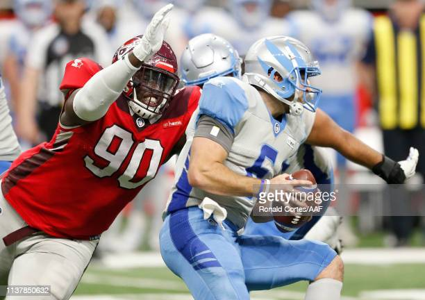 Joey Mbu of San Antonio Commanders reaches to stop Josh Woodrum of Salt Lake Stallions during the second quarter of the Alliance of American Football...