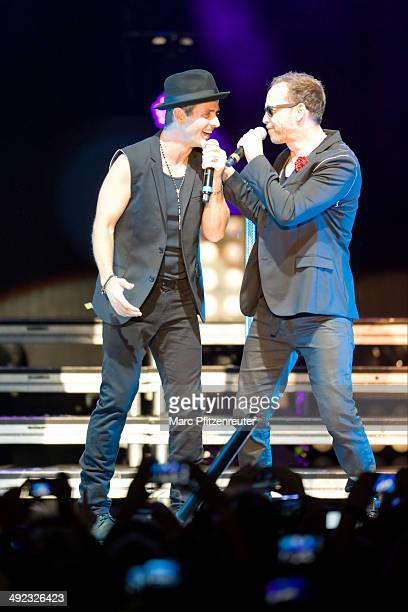 Joey McIntyre and Donnie Wahlberg of American Boygroup New Kids On The Block performs during their 'Let's get Intimate Tour 2014' at the Palladium on...