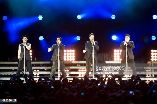 Joey McIntyre Danny Wood Jordan Knight and Jonathan Knight of American Boygroup New Kids On The Block perform during their 'Let's get Intimate Tour...