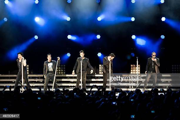 Joey McIntyre Danny Wood Jordan Knight Jonathan Knight and Donnie Wahlberg of American Boygroup New Kids On The Block perform during their 'Let's get...