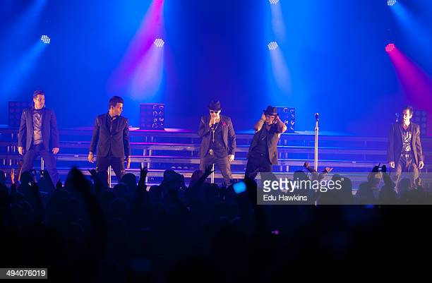 Joey McIntyre Danny Wood Jordan Knight Jonathan Knight and Donnie Wahlberg of New Kids On The Block perform on stage at Eventim Apollo Hammersmith on...