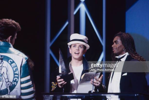 Joey McIntyre Fab Morvan New Kids On The Block receiving award on the 17th Annual American Music Awards Shrine Auditorium January 22 1990