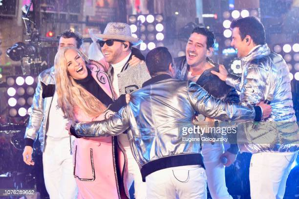 Joey McIntyre Jenny McCarthy Donnie Wahlberg Danny Wood Jonathan Knight and Jordan Knight on stage at With Ryan Seacrest 2019 on December 31 2018 in...