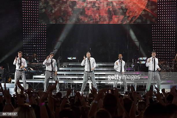 Joey McIntyre Jonathan Knight Donnie Wahlberg Danny Wood and Jordan Knight of New Kids On The Block perform in concert at the Verizon Wireless Music...