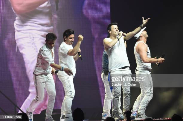Joey McIntyre Jonathan Knight Jordan Knight Danny Wood and Donnie Wahlberg of New Kids On The Block performs at US Bank Arena on May 02 2019 in...