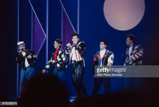 Joey McIntyre Jonathan Knight Jordan Knight Danny Wood Donnie Wahlberg of New Kids On the Block performing on the 17th Annual American Music Awards...
