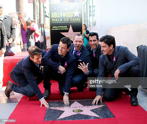 Joey McIntyre Jonathan Knight Jordan Knight Donnie Wahlberg and Danny Wood of New Kids On the Block pose with 2530th star on the Hollywood Walk of...