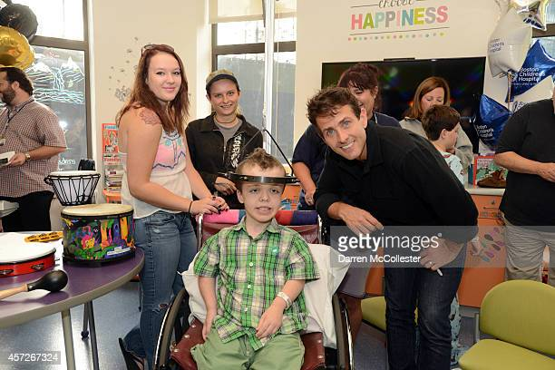 Joey McIntyre spends time with Alex at Boston Children's Hospital October 15 2014 in Boston Massachusetts