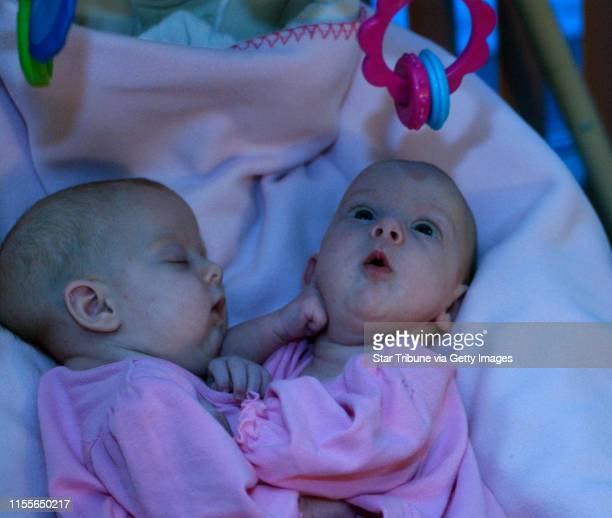 Joey McLeister ¥ jmcleister@startribunecom FargoNDFeb 1 2006 Abbigail Carlsen sleeps as Isabelle Carlsen studies a mobile above their swing at home...