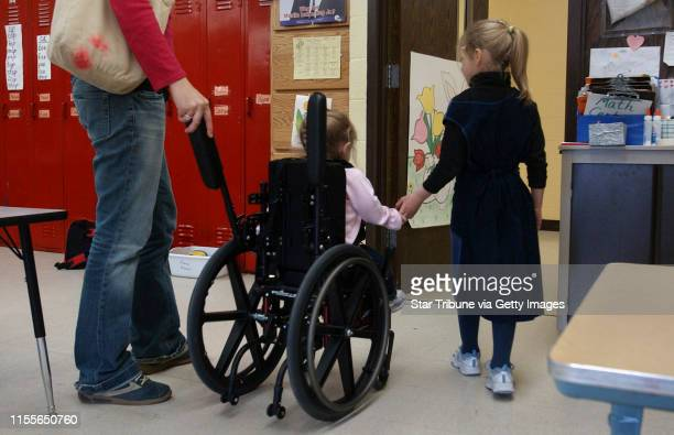 Joey McLeister ¥ jmcleister@startribunecom International FallsMnThursApril 6 2006 Personal care assistant Danni Kallerman pushes Hope Moss's...
