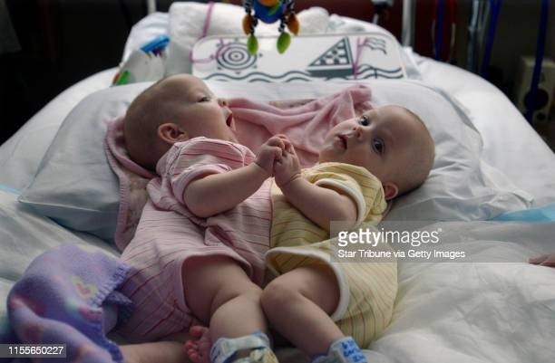 Joey McLeister ¥ jmcleister@startribunecom Rochester Mn Tues April 11 2006Abbigail and Isabelle Carlsen in their special heated bed at the Mayo...
