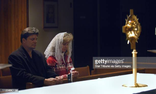 Joey McLeister/Star Tribune Coon RapidsMnSatJan 22 2005 Jim and Judy Loeffler of Elk River pray in front of the Monstrance during their 2 am to 3 am...