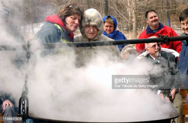 Joey McLeister/Star Tribune DaytonMnWedsMar 9 2005 Sharon Zachman and Norma Wilson take a closer look at the steaming cook kettle where sap from...