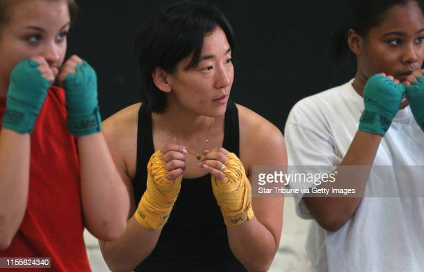 Joey McLeister/Star Tribune MinneapolisMnSatJune 5 2004 Boxing student 16yearold Ruby Hocker works with instructor Sarah Mickelson as does 15yearold...