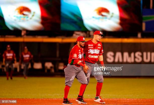 Joey Meneses and Alfredo Amezaga of Tomateros de Culiacan of Mexico celebrate after scoring against Aguilas Cibaenas of Republica Dominicana during...