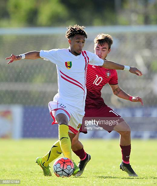 Joey Milimono of Guinea is tackled by Andre Horta of Portugal during the Toulon Tournament match between Portugal and Guinea at Stade De Lattre on...