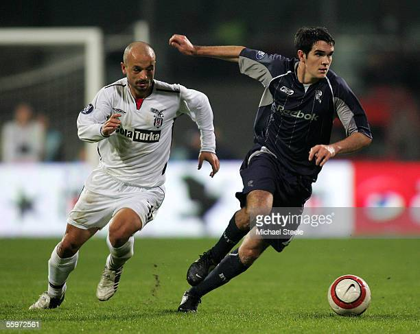 Joey O'Brien of Bolton escapes from Koray Avci during the Uefa Cup Group H match between Besiktas and Bolton Wanderers at the BJK Inonu Stadium on...