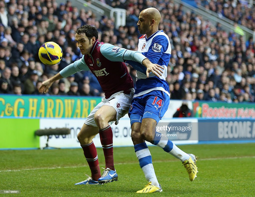 Joey O'Brien of West Ham United holds off Jimmy Kebe of Reading during the Barclays Premier League match between Reading and West Ham United at the Madejski Stadium on December 29, 2012 in Reading, England.