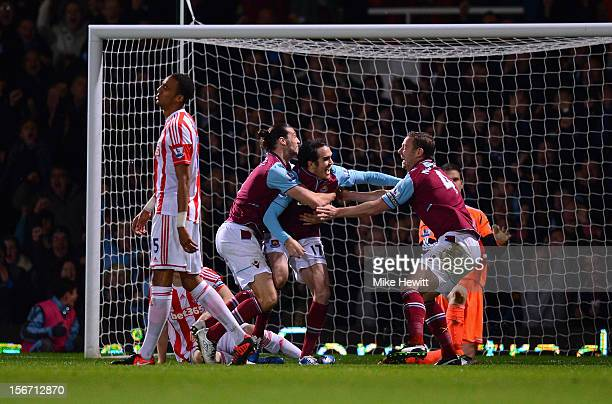 Joey O'Brien of West Ham United is congratulated by team mates Andy Carroll and Kevin Nolan after scoring during the Barclays Premier League match...
