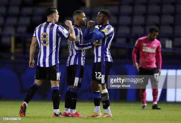 Joey Pelupessy, Elias Kachunga and Moses Odubajo of Sheffield Wednesday celebrate victory following the Sky Bet Championship match between Sheffield...