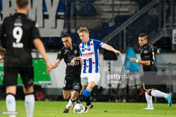 Joey Pelupessy of Heracles Almelo Martin Odegaard of sc Heerenveen during the Dutch Eredivisie match between sc Heerenveen and Heracles Almelo at Abe...