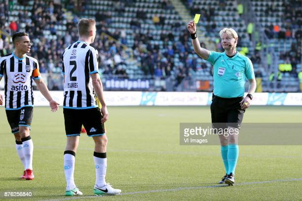 Joey Pelupessy of Heracles Almelo Tim Breukers of Heracles Almelo referee Kevin Blom during the Dutch Eredivisie match between ADO Den Haag and...
