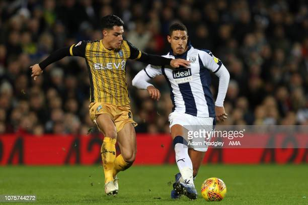Joey Pelupessy of Sheffield Wednesday and Jake Livermore of West Bromwich Albion during the Sky Bet Championship match between West Bromwich Albion...