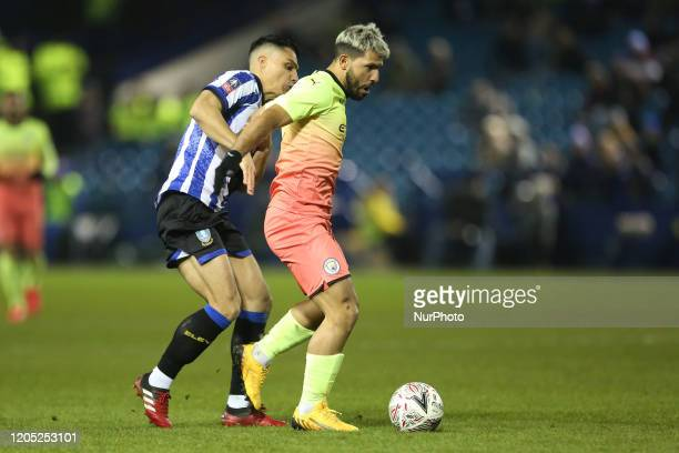 Joey Pelupessy of Sheffield Wednesday in action with Sergio Aguero of Manchester City during the FA Cup Fifth Road match between Sheffield Wednesday...
