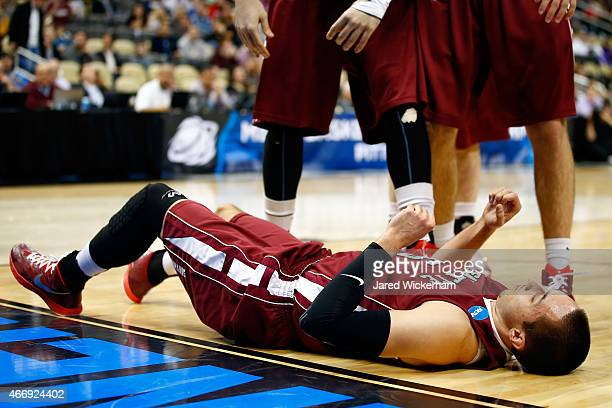 Joey Ptasinski of the Lafayette Leopards lays on the ground after fouling out JayVaughn Pinkston of the Villanova Wildcats in the first half during...