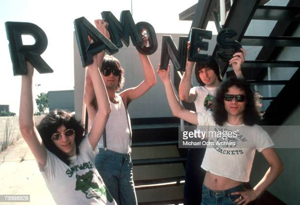 """Joey Ramone, Dee Dee Ramone, Johnny Ramone and Tommy Ramone of the rock and roll band """"The Ramones"""" pose for a portrait holding letters that spell..."""
