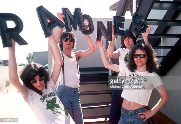 Joey Ramone Dee Dee Ramone Johnny Ramone and Tommy Ramone of the rock and roll band The Ramones pose for a portrait holding letters that spell out...