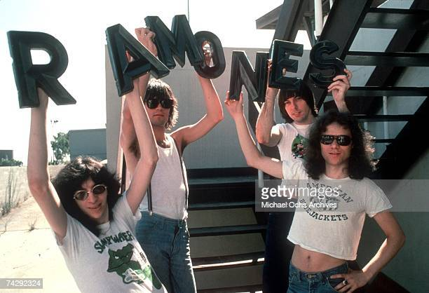 Joey Ramone Dee Dee Ramone Johnny Ramone and Tommy Ramone of the rock and roll band 'The Ramones' pose for a portrait holding letters that spell out...