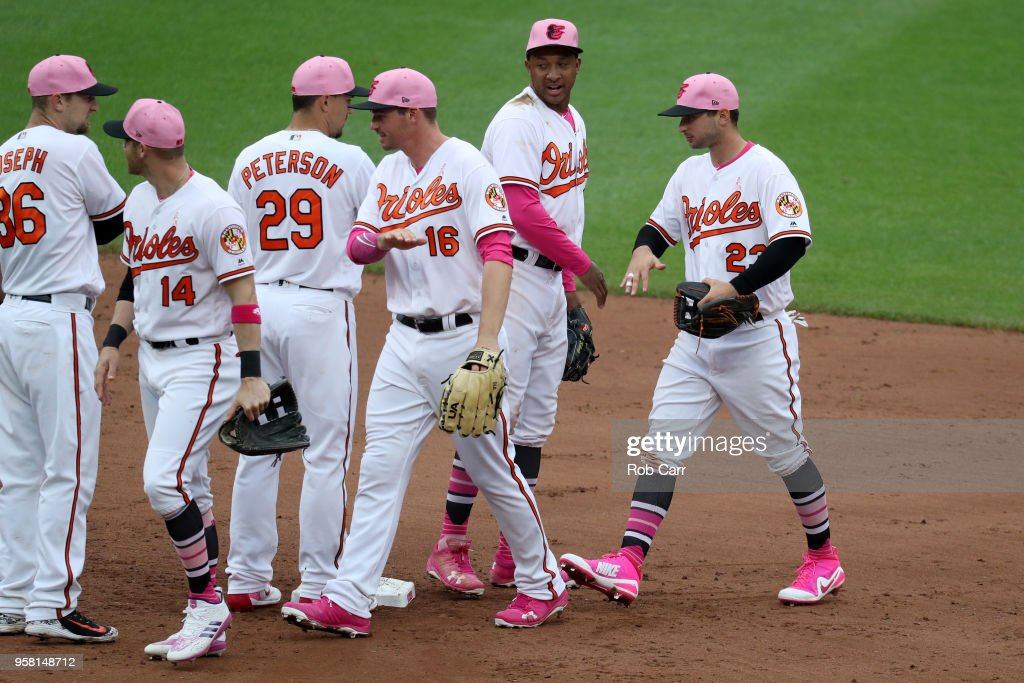 Joey Rickard #23 of the Baltimore Orioles celebrates with teammates following the Orioles 17-1 win over the Tampa Bay Rays at Oriole Park at Camden Yards on May 13, 2018 in Baltimore, Maryland.