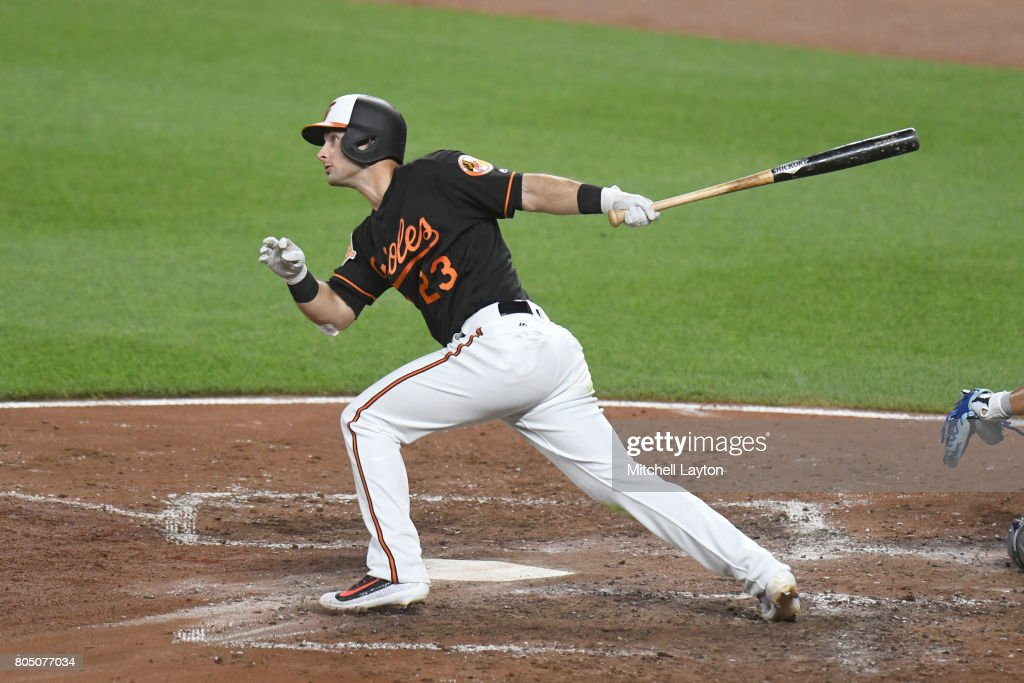 Joey Rickard #23 of the Baltimore Orioles hits a solo home run in the sixth inning during a baseball game against the Tampa Bay Rays at Oriole Park at Camden Yards on June 30, 2017 in Baltimore, Maryland.