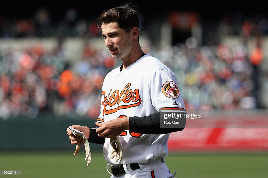 Joey Rickard #23 of the Baltimore Orioles looks on after grounding out for the third out of the seventh inning against the Tampa Bay Rays at Oriole Park at Camden Yards on April 10, 2016 in Baltimore, Maryland.
