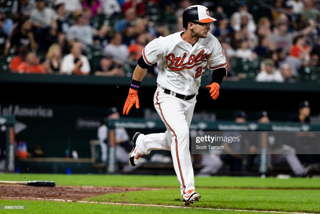 Joey Rickard #23 of the Baltimore Orioles singles against the New York Yankees during the eighth inning at Oriole Park at Camden Yards on July 11, 2018 in Baltimore, Maryland.