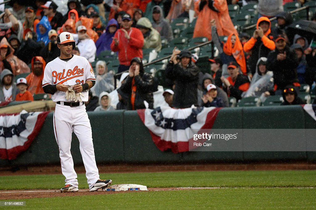 Joey Rickard #23 of the Baltimore Orioles stands on the bag after recording his first major league hit against the Minnesota Twins in the second inning during their Opening Day game at Oriole Park at Camden Yards on April 4, 2016 in Baltimore, Maryland.